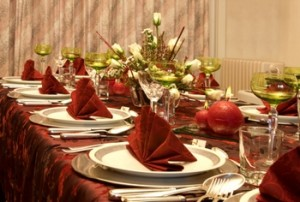 Christmas dinner table with flowers and red napkins